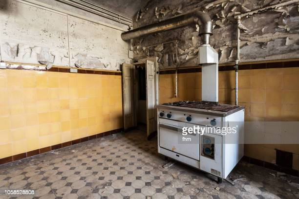 old kitchen in an abandoned building - ruined stock pictures, royalty-free photos & images