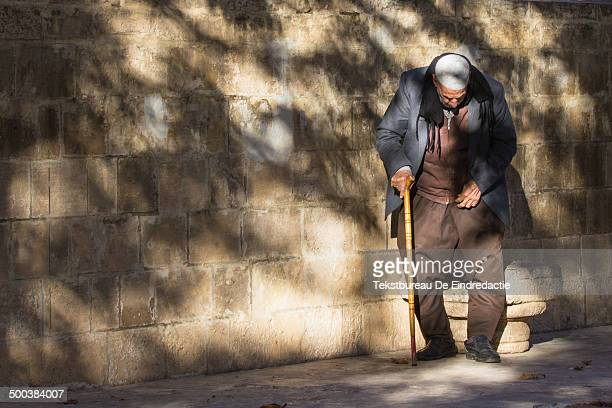 Old kurdish muslim man, wearing traditional baggy trousers, at sunset, in the old city centre of Sanliurfa , southeastern Turkey. The region is...
