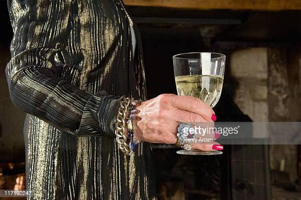 old ladies hand with glass of wine - kitsch stock pictures, royalty-free photos & images