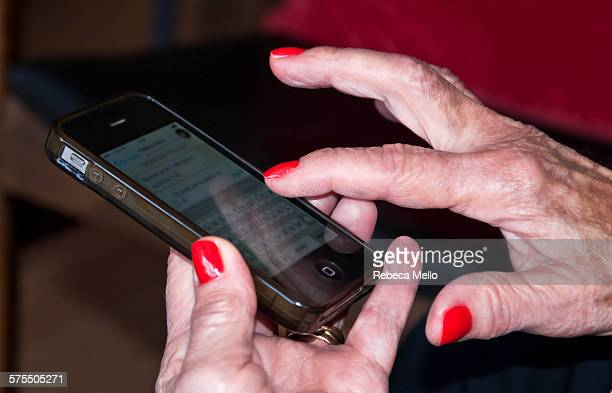 Old lady is typing on mobile phone showing just her hands learning to talk using message Jundiaí São Paulo state Brazil August 2015
