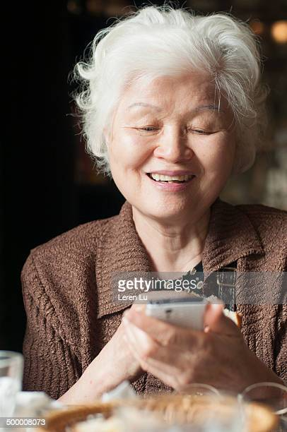 Old lady looking at smartphone