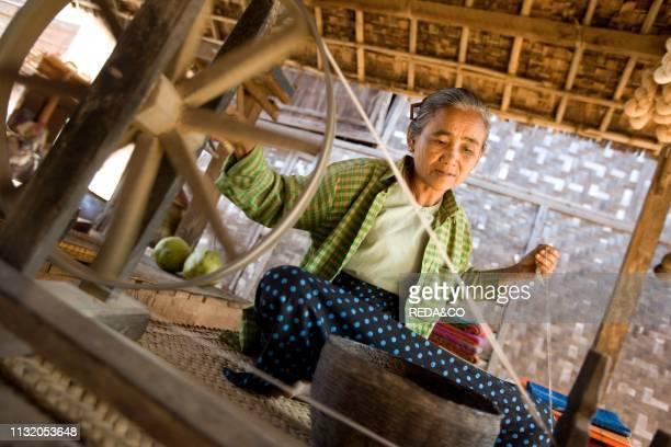 Old lady spinning a woolen thread Phwaso Village Bagan Myanmar Burma Southeast Asia