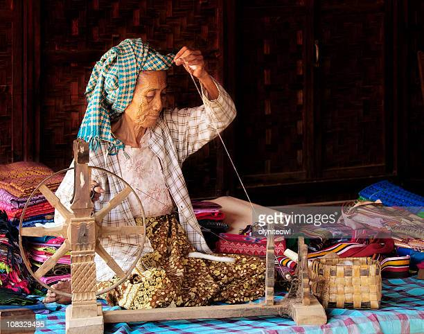 Old Lady Spinning Cotton