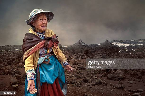 Old lady wearing traditional Colca clothing, intricately embroidered and brightly colored skirts, vest and hat. Many locals speak Quechua as their...