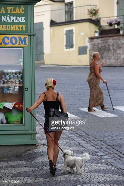 Old lady with a cane across the street, while the young walks the dog - Banská Stiavnica - Slovakia/Slovensko