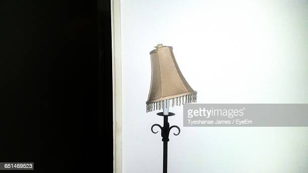 Old Lamp Against White Wall