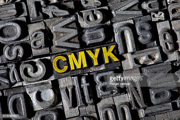 Old lead letters forming the word CMYK