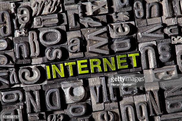 Old lead letters spelling the word INTERNET