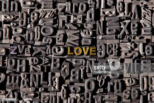 Old lead type forming the words love