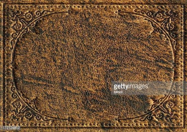 old leather bookcover with engraved scroll pattern - wild west stock pictures, royalty-free photos & images