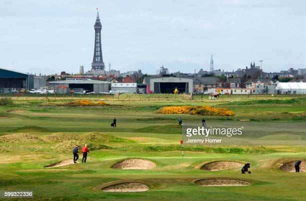old links golf course with blackpool pleasure beach and tower in background., lytham st annes, lancashire - blackpool beach stock pictures, royalty-free photos & images