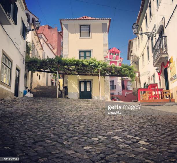 old lisbon street in alfama district, portugal - alfama stock photos and pictures