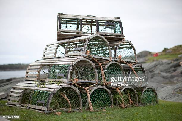 old lobster traps - crab pot stock photos and pictures