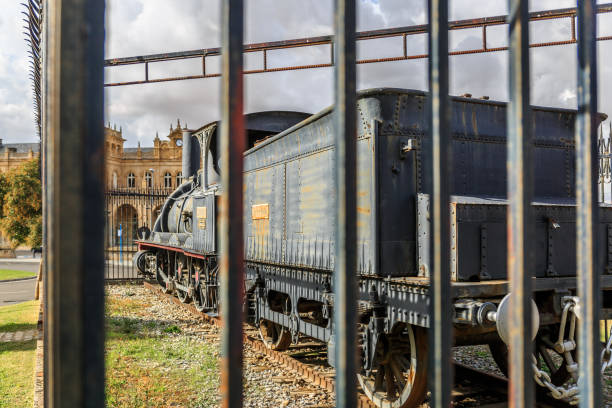 Old Locomotive Of A Vintage Train Next To A Station