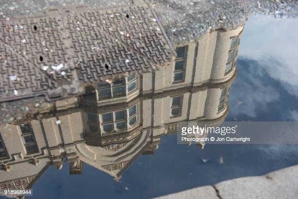 Old London building reflected in a puddle