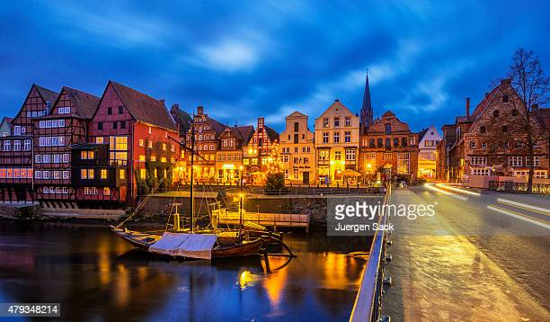 old luneburg (luneberg) harbour at night - lüneburg stock photos and pictures