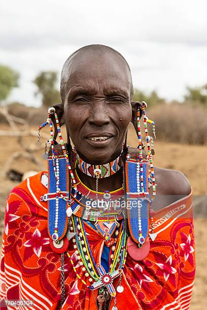 Old maasai woman with impressive traditional colorful pearl jewellery.
