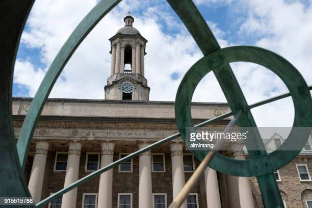 old main and sundial statue at state college - state college stock photos and pictures