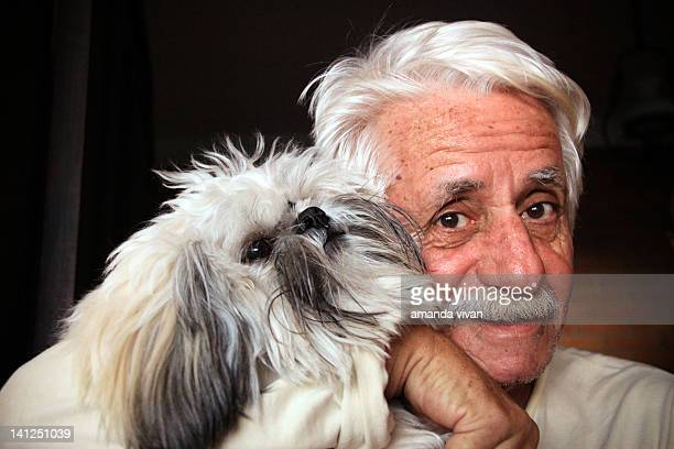 old man and dog - hairy old man stock pictures, royalty-free photos & images