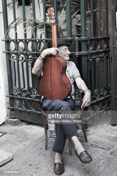 Old man and his guitar