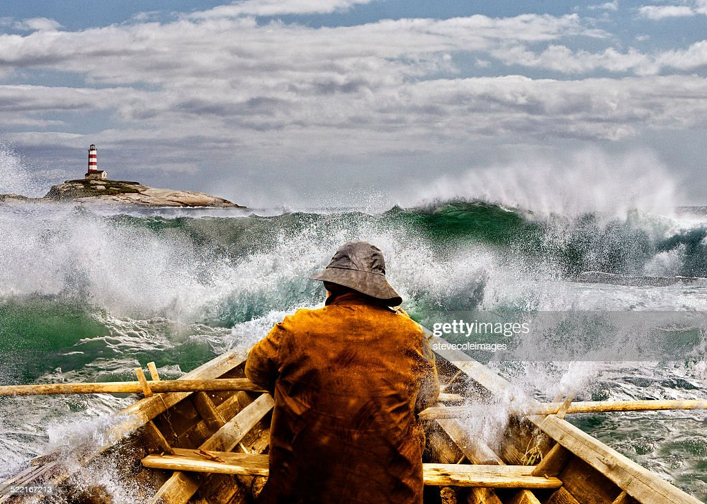 Old man and the Sea in a Skiff : Stock Photo
