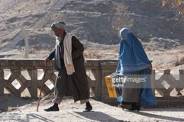 Old Man And Woman Wearing A Burqa On A Kabul Street Afghanistan