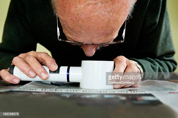 old man dealing with macular degeneration - degeneration stock photos and pictures