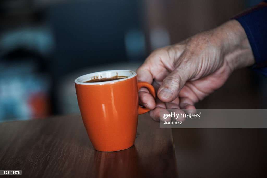 Old man drinking a coffee-close up : Stock Photo