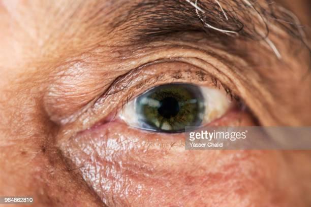 old man eye - black eye stock pictures, royalty-free photos & images