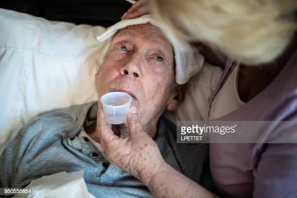 old man fever - hospice stock pictures, royalty-free photos & images