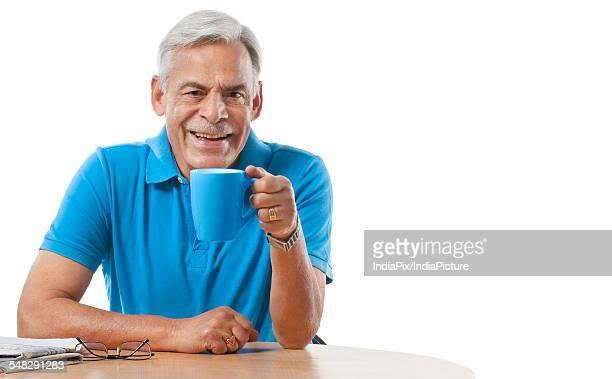 Old man having a cup of tea