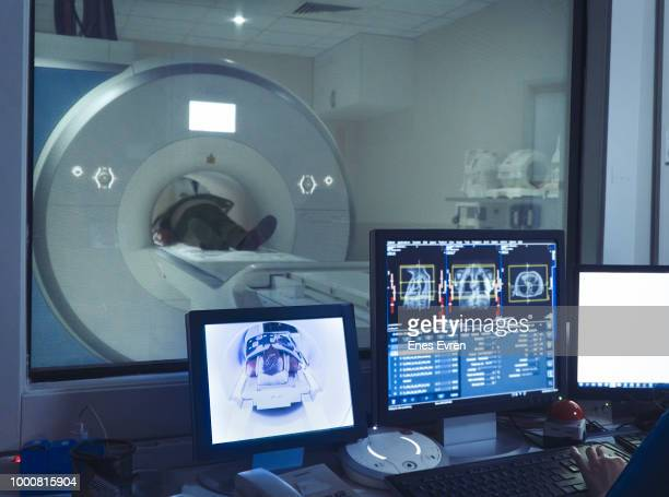 old man having mri scan - cat scan machine stock pictures, royalty-free photos & images