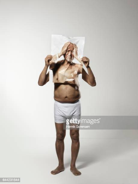 old man holding a picture of himself - boxershort stock pictures, royalty-free photos & images