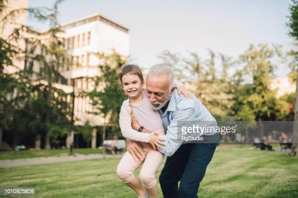Old man hugging granddaughter
