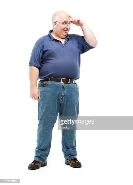 Old man in jeans and polo thinking with hand to his head