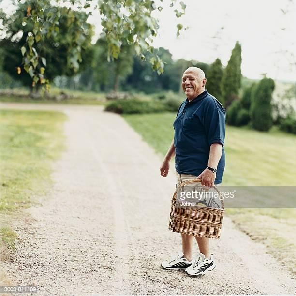 Old Man in Park Carries Basket