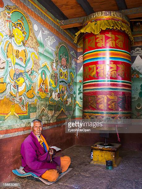 A old man in the monastery in the village Chimi Lhakhang in the Punakha Valley with its temple monastery is renowned for its fertility blessings...