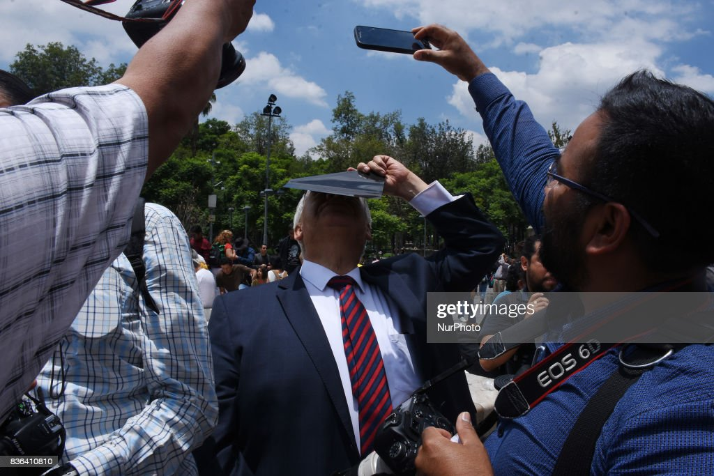 A old man is seen looking the Partial Solar Eclipse viewed from the Mexico City on August 21, 2017 in Mexico City, Mexico