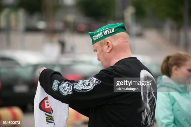 old man looking for tshirt at flea market  helsinki finland