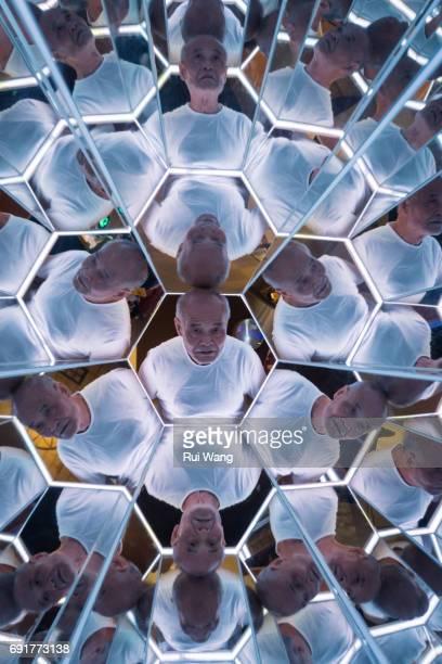 Old man looking in kaleidoscope