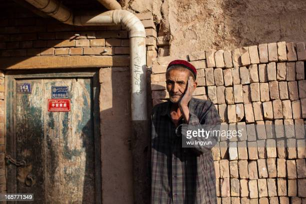 Old man of Kashgar ancient city hooted his complains on ancient city's reconstruction plan because his low income family can not pay for it.