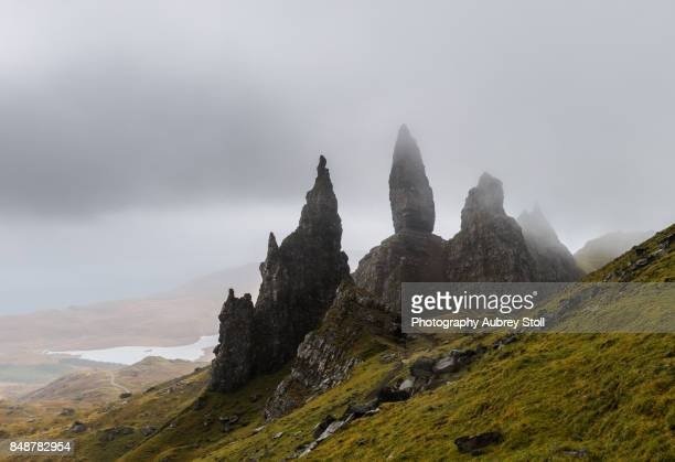 old man of storr in the mist - nautre stock pictures, royalty-free photos & images