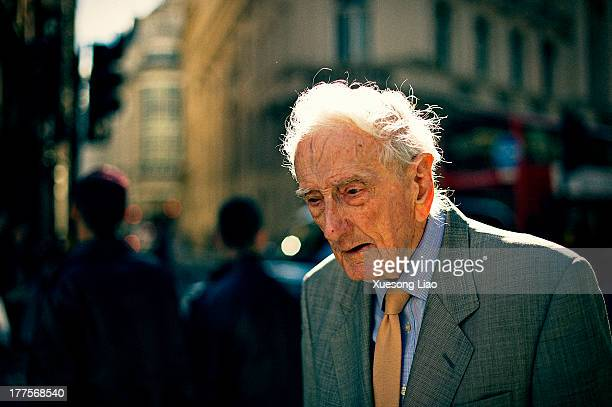 Old man, old man in suit, walking on street,visible veins, thinking, pensive