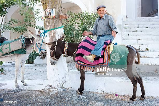 Old man on a donkey, Pyrgos, Santorini, Greece