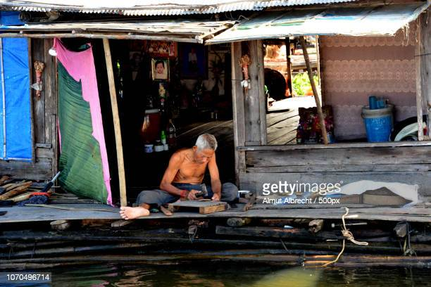 old man on a floating house