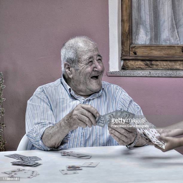 Old man playing cards.