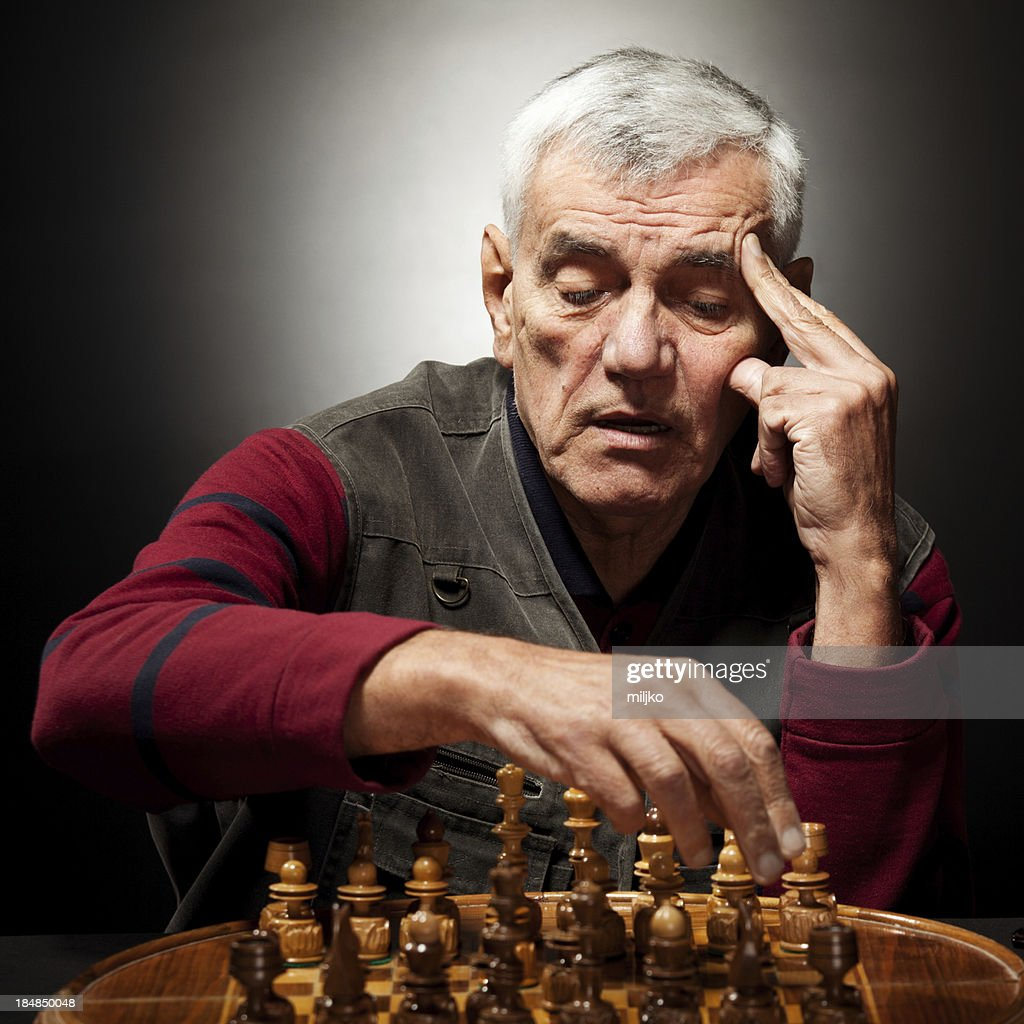 Old man playing chess : Stock Photo