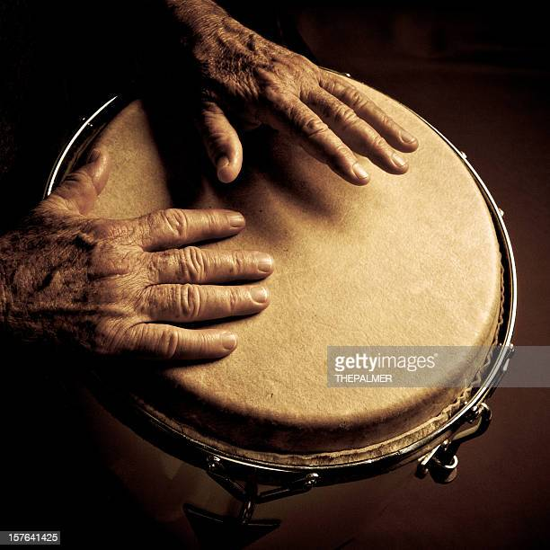 old man playing congas - percussion instrument stock photos and pictures