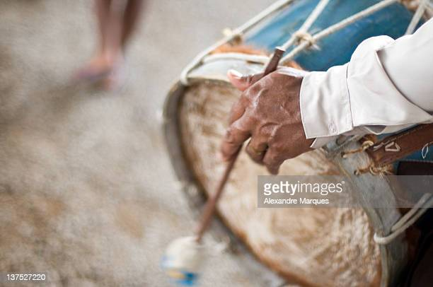 old man playing drum - bamboo instrument stock photos and pictures