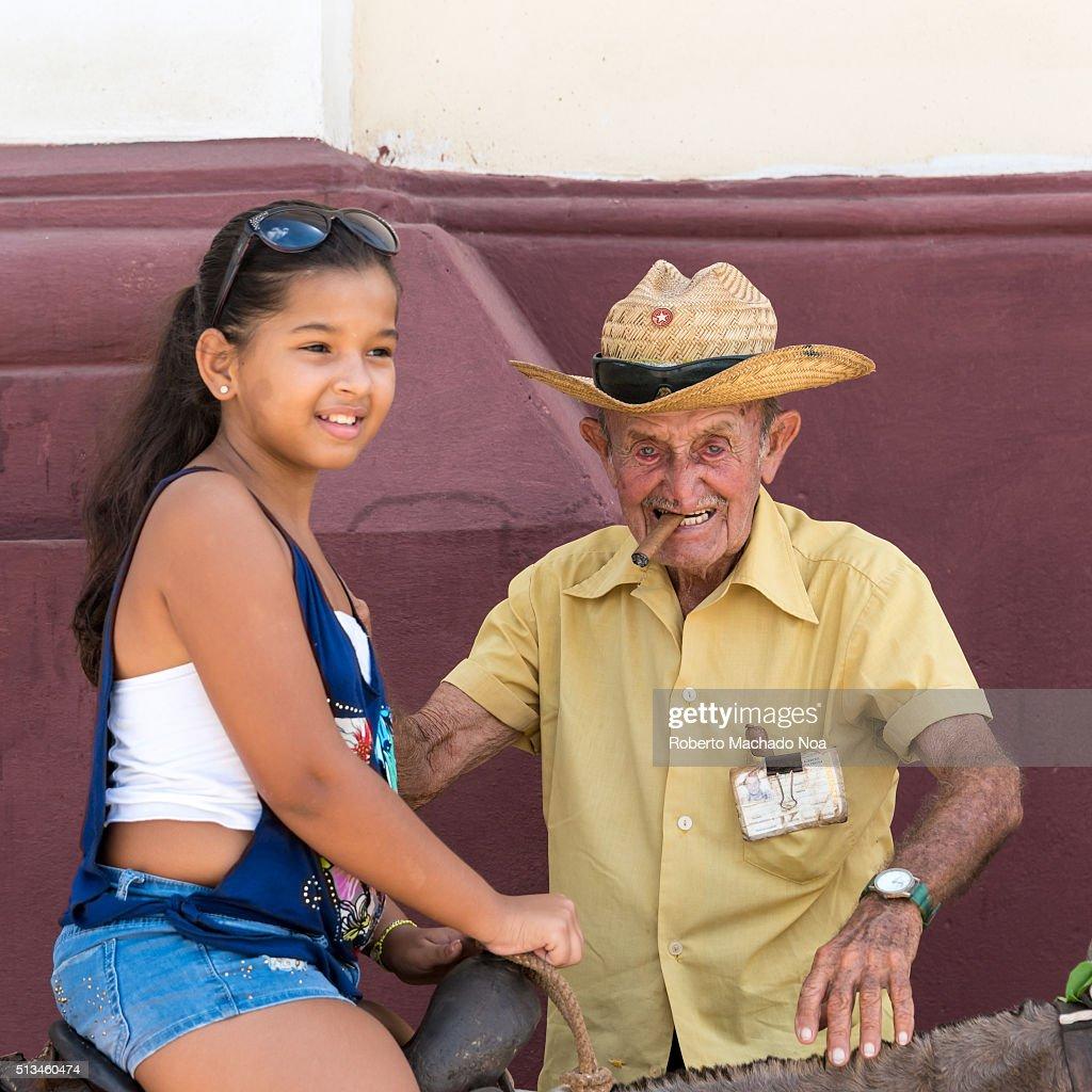 Teen girl rides old man